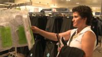 Woman looks at clothes