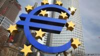 The Euro logo in front of the European Central Bank ECB, Frankfurt.