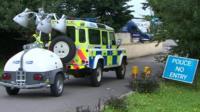 Police vehicle outside farm near Newport