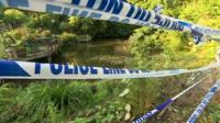 Police tape at pond crash scene