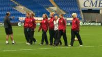 Wales women football team check the pitch