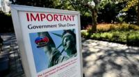 A notice explaining the Statue of Liberty is closed due to the US Government shutdown