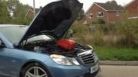 Car with open bonnet