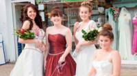 PDSA volunteers model some of the donated dresses