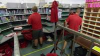 Royal Mail staff in sorting office
