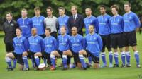 "The Duke of Cambridge stands with members of the Polytechnic FC prior to their match against the Civil Service FC, in the grounds of Buckingham Palace""s garden"