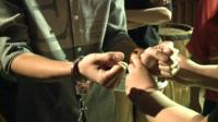 Man being handcuffed