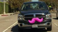 Car with a pink moustache on the front