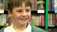 A boy in a bookshop