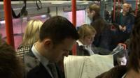Commuters on packed train