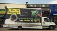 Van with 'go home' message