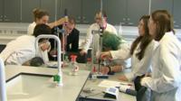 Students carrying out experiment