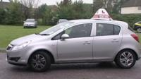 A learner driver in a car