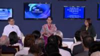 (L) Minister for Economic Reforms, U Soe Thane, (c) Burmese MP Aung San Suu Kyi, (R) Burmese political activist, Zin Mar Aung