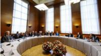 Delegations from Iran and other world powers sit before the start of two days of closed-door nuclear talks at the United Nations offices in Geneva