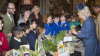 Duchess of Cornwall and schoolchildren at harvest festival