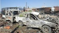 A handout photo from Syria's state owned news agency of the aftermath of the bombing