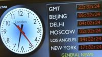 A screen showing the time around the world at New Broadcasting House