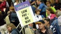 Low Pay - No Way Unison placard being held at a demonstration