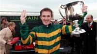 File photo dated 07/11/2013 of Tony McCoy celebrating his 4000th winner after victory in the Weatherbys Novices´ Hurdle at Towcester Racecourse