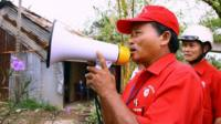 Local Red Cross official alert local residents to move out