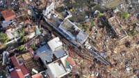 An aerial view of devastation and a ship after it was swept at the height of super typhoon Haiyan in Tacloban city in central Philippines