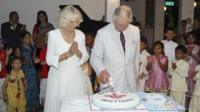 Prince Charles cuts a birthday cake next to his wife Camilla, Duchess of Cornwall,