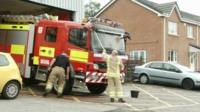 Fire crew wash a fire engine