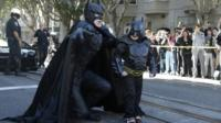 Miles Scott (right), walks with a man dressed as Batman in San Francisco, California, on 15 November 2013