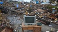 A television set sits on a table on a road amongst debris in Tacloban City on November 14, 2013 in Tacloban, Philippines