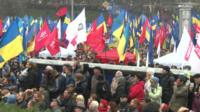 Protesters with the flags of various political parties in Kiev's European Square