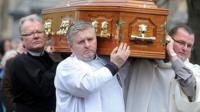 Coffin outside church
