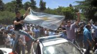 Striking policemen celebrate winning pay rise