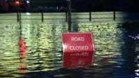 Flooded road with 'road closed' sign