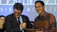 WTO Director General Roberto Azevedo and Indonesia's Trade Minister Gita Wirjawan after the final agreement of the WTO conference