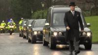 The funeral cortege, complete with honour guard of police outriders