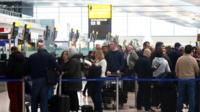 Queues of passengers at airport terminal