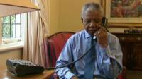 archive picture of Nelson Mandela making phone call