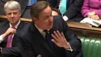 David Cameron waving