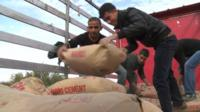 Traders deliver cement at the Oncupinar border between Syria and Turkey