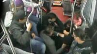 CCTV shows passengers holding thief on bus floor