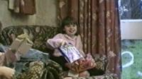 Johanna Young opening Christmas presents in a family video