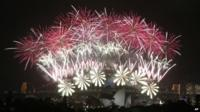 """Fireworks explode over the Harbour Bridge and the Opera House during New Year""""s Eve celebrations in Sydney"""