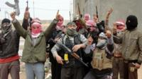 Iraqi men from local tribes brandish their weapons