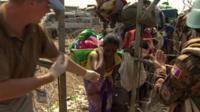 Fleeing Bentiu residents enter a UN compound