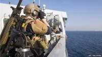 A photo of Norwegian naval forces as the ship secures the port of the Syrian city of Lakakia during an operation to move chemical agents from Syria