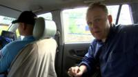 The BBC's Angus Crawford travels with a police escort in a car in Ibabao in the Philippines