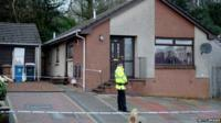 Policeman outside sealed-off property