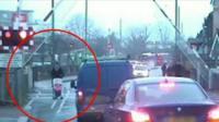 Man pushing pushchair jumps level crossing