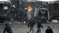 Riot police officers gather during clashes with protesters in Kiev